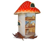 Revolving toadstool dolls house