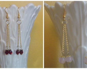Price reduced to 3.00 ... Double Bead Dangle Earrings on Gold tone metal ... your choice Red or Pink