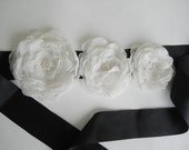 Black ribbon and white flower sash belt,