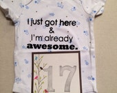 DISCOUNTED -- Nearly Perfect -- #17b, see photos -- I just got here & I'm already awesome.  -- star bodysuit, size 0-3 months