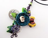 Dia de los Muertos Cross wire wrapped with polymer clay flowers and skull, metal gears, and a butterfly