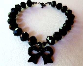 Black crystal bead necklace with bow medalion