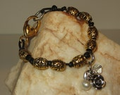 Knotted Black Leather Cord Bracelet with Brass Beads and Charms