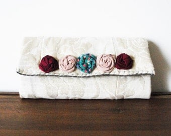 Sparkly Embossed Floral Ivory Envelope Fabric Clutch Wallet with Row of Rosettes