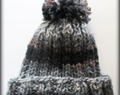 Beautiful blends of grays, browns and blacks hand knit pom pom hat