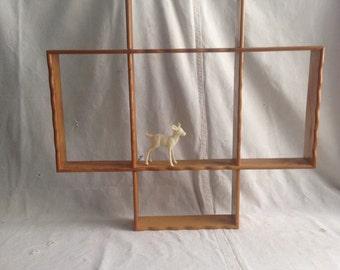 Vintage interlocking wood shelf. Display shelf