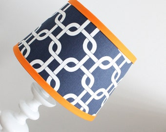 Small Navy and white lamp shade with orange accent.