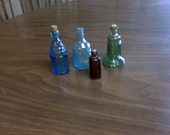4 colored small bottles