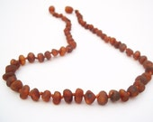 Raw Unpolished  Cognac color Baltic Amber Baby  Teething Necklace.  Maximum pain relief.