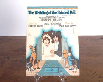 """The Wedding of the Painted Doll, vintage sheet music, 1920s, from MGM movie musical """"Broadway Melody of 1929,"""" orange, blue, bride and groom"""