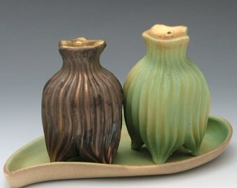 Hand carved bronze and green salt & pepper shakers with gold luster