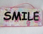 Plaque: SMILE