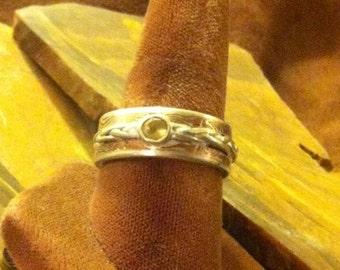 Men's Mokume band Braided silver. 4mm citrine round set in bezel setting.