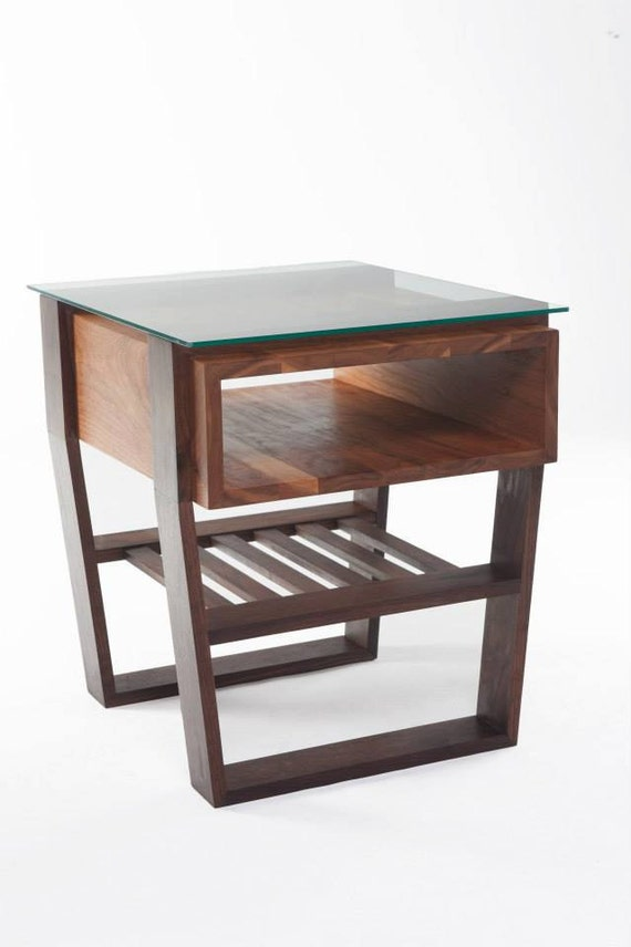 Modern cherry and walnut end table with glass top.