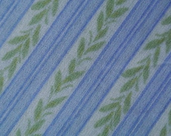 Vintage 1970s quilt fabric in highquality prewashed cotton with small printed blue stripes and green leafe pattern on white bottomcolor