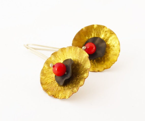 Tiny black poppy earrings. Brass flowers with tiny black poppy centres.