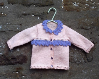 "Hand knitted baby girls peach with lilac trim cardigan. 16"" chest."