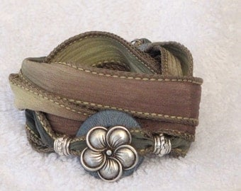 Silk Ribbon Whirly Wrap Bracelet in soft sand sage and teal with an antique silverfive petal flower button