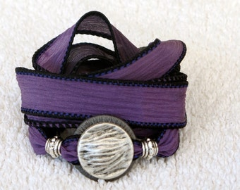 Silk Ribbon Whirly Wrap Bracelet in deep plum with a silver button with swaying grasses