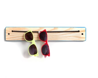 The Ash iWear Rack with colored edges.  Organization for sunglasses and eyewear.