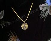 Golden Serenity Medallion Pendant