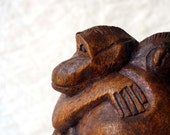 Monkey hugs, carved wooden monkey sculpture