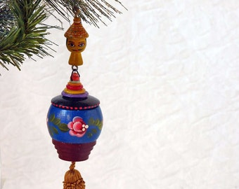 Wooden Christmas ornament, assemblage ornament with gold tassel and painted wood parts