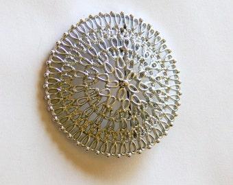 Vintage silvertone  round  brooch