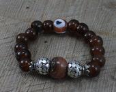 Gypsy Bohemian Bracelet Handmade Orange Evil Eye and Brown Crow Beads with Bali Style Silver Beads