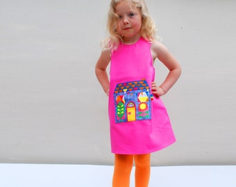Little girls house pocket pinafore dress in fuchsia cotton.