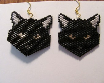 A beautiful pair of Black Cat with gold eyes head earrings