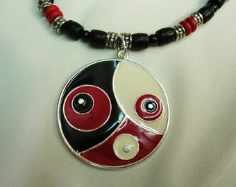 Bold Black Red and White Circle Pendant set on Black Red and Silver Beaded 18 Inch Necklace with a Sturdy Magnetic Clasp