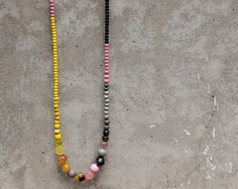 Long colour block necklace, wooden bead necklace, pink, grey, yellow, contemporary.