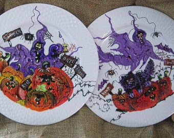 Set of 2 10 inch plastic plates, Ghastly Duo and a bunch of Rotten Pumpkins
