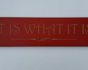 "Carved ""It Is What It Is"" sign"
