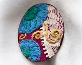 Embroidered flower swirl design brooch with lace