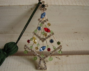 vintage jewelled charm,tree design silver finish with brightly coloured stones-green tassle