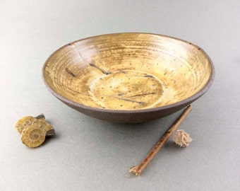 Golden yellow and brown earthen bowl