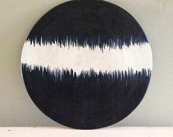 Ceramic plate, nearly black deep blue and white organic design. Brushed lines.