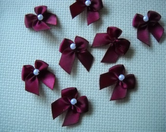 Maroon/ dark red ribbon bows, embellishments with faux pearl beads. Set of eight. Other colors available. 1 inch