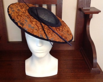 Navy sinamay picture hat, with brass lace brim