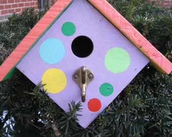 Wren birdhouse.  Hand painted in bright purple,yellow,green and orange.