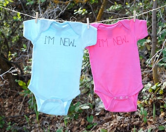 I'M NEW. - Baby Bodysuit in Blue or Pink (You choose size and color)