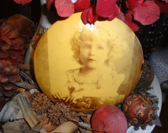 PRECIOUS Sepia tone Photo button of a blond curly haired girl.