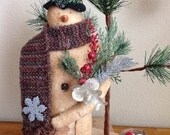 Primitive snowman handcrafted from warm and natural