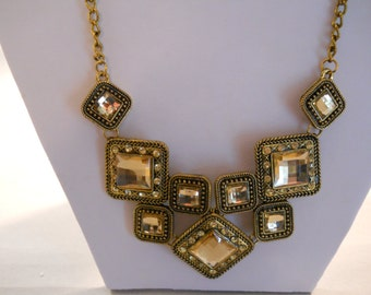 Bib Necklace With Gold Tone and Rhinestone Pendants on a Gold Tone Chain