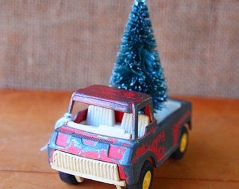 1969 Tootie Carry Truck with Red Chippy Paint and a Green Wired Tree