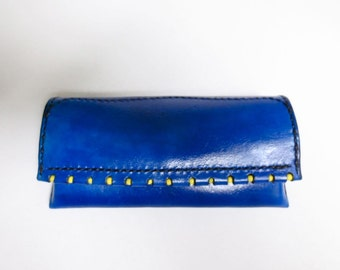 Suede lined electric blue leather eyeglass case with yellow glass bead edge inlay.