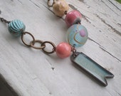 Carefree necklace- artisan lampwork bead.pastel ceramic beads. resin pendant. fresh pastel jewelry. woodland necklace. Jettabugjewelry