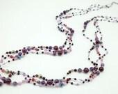 Purple color amethyst multi stone on silk thread necklace.